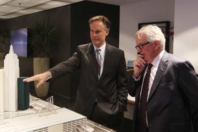 AEG Senior Vice President Mark Faber, left, shows off a model of the new Las Vegas Arena, not pictured, to businessman Bill Foley Thursday, Jan. 15, 2015 at New York New York. Foley is attempting  ...