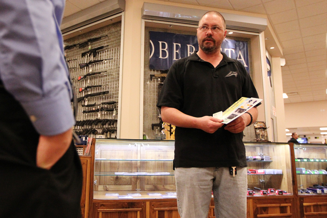 Bill Smallwood, gunsman at The Range 702, is interviewed on the store's partnership with the Nevada Office of Suicide Prevention at The Range 702 in Las Vegas Wednesday, Feb. 4, 2015. (Erik Verduz ...