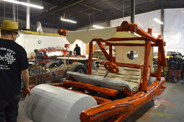 """A """"Flintstones"""" car awaits finishing touches inside Jay Ohrberg's workshop at the Hollywood Car Museum in Hot Rod City, 5115 Dean Martin Drive. (Ginger Meurer/View)"""