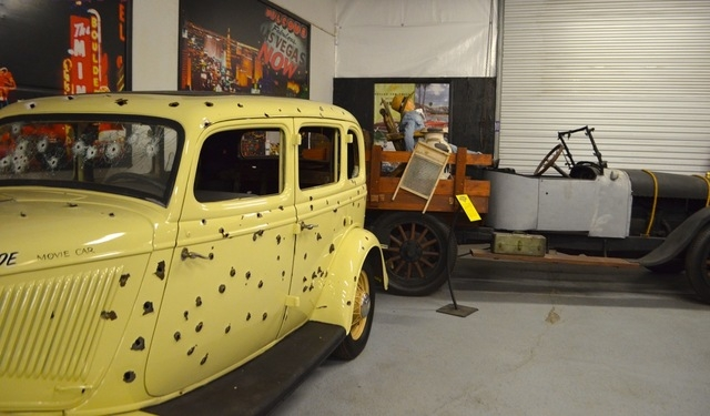 """Jay Ohrberg's version of the Bonnie and Clyde death car sits beside his reproduction of the Clampett's truck from """"The Beverly Hillbillies.""""  (Ginger Meurer/View)"""