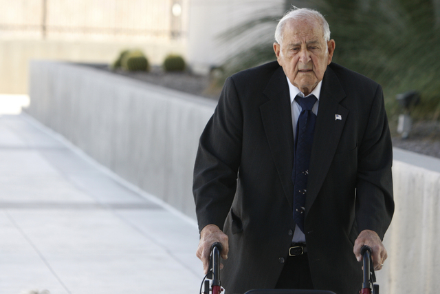 Salvatore Ruvolo, co-defendant in a federal case involving fraud and corruption at Las Vegas homeowners associations, walks to Lloyd George Federal Courthouse in Las Vegas Wednesday, Feb. 25, 2015 ...