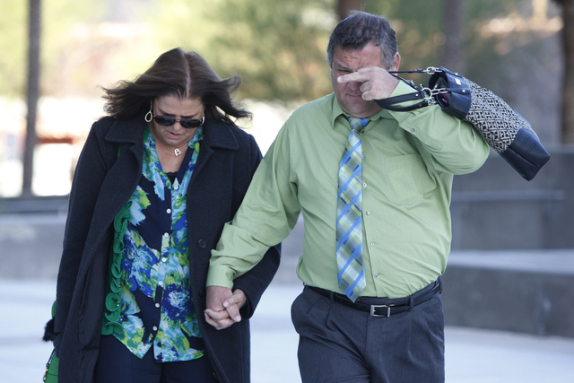 David Ball, right, co-defendant in a federal case involving fraud and corruption at Las Vegas homeowners associations, walks to Lloyd George Federal Courthouse in Las Vegas with an unidentified wo ...