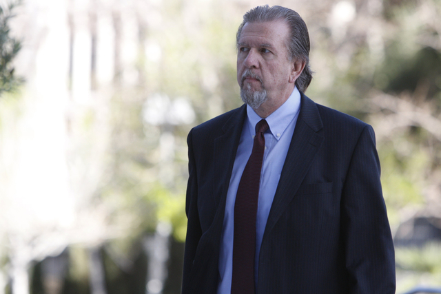 Keith Gregory, attorney and defendant in a federal case involving fraud and corruption at Las Vegas homeowners associations walks to Lloyd George Federal Courthouse in Las Vegas Wednesday, Feb. 25 ...