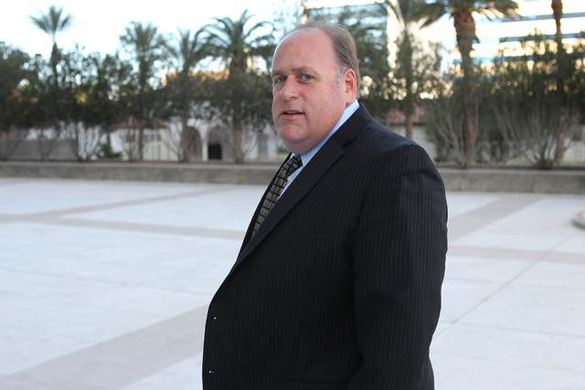 Chris Rasmussen, attorney for co-defendant Edith Gillespie in a federal case involving fraud and corruption at Las Vegas homeowners associations, walks to Lloyd George Federal Courthouse in Las Ve ...