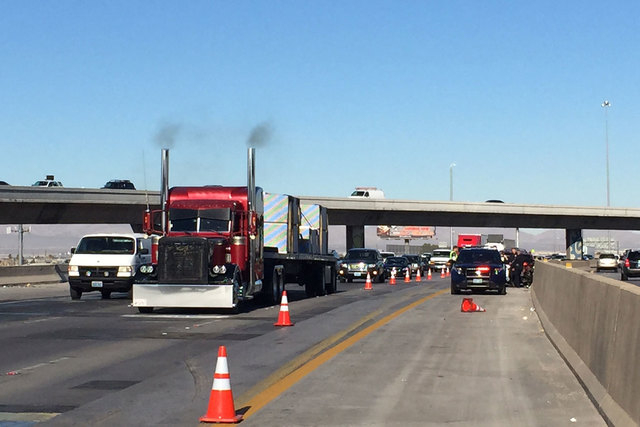 One person is dead after a crash on southbound Interstate 15 in the Spaghetti Bowl Monday afternoon, Feb. 2, 2015, a Nevada Highway Patrol spokeswoman said. (Chase Stevens/Las Vegas Review-Journal)