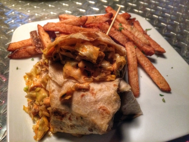 Hi Scores Bar-Arcade serves less traditional bar meals, including a Buffalo chicken wrap in a flour tortilla, served with french fries. (Fernando Lopez/Special to View)