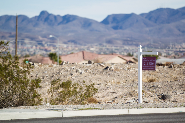 A real estate sign is seen at the corner of an empty lot where a longtime local doctor, Osama Haikal, is looking to develop an Islamic cemetery off of Bermuda Road near Eldorado Lane in Las Vegas  ...