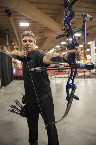 1992 Olympic gold medalist in archery from Spain, Juan Carlos Holgado loosens up on his bow during the world's largest indoor archery tournament called The Vegas Shoot held at the South Point hote ...