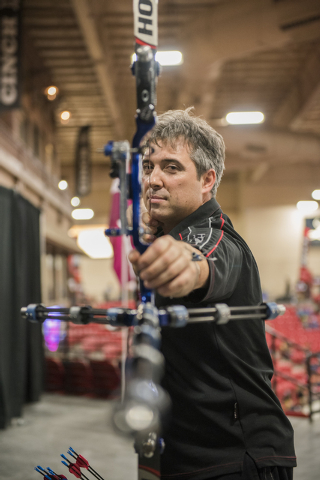 1992 Olympic gold medalist in archery from Spain, Juan Carlos Holgado poses for a portrait with his bow during the world's largest indoor archery tournament called The Vegas Shoot held at the Sout ...