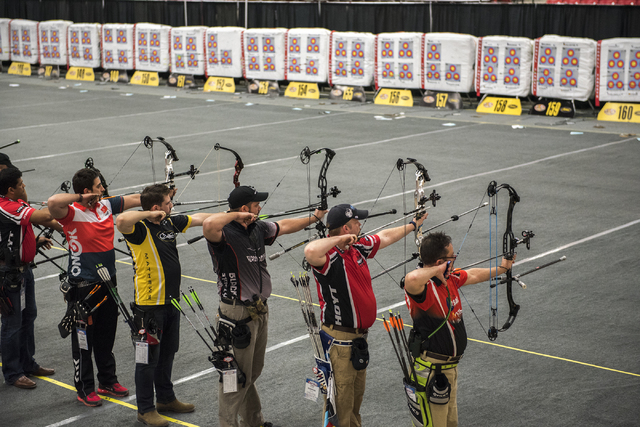 Participants compete in the world's largest indoor archery tournament called The Vegas Shoot held at the South Point hotel-casino in Las Vegas, Friday Feb. 6, 2015. (Martin S. Fuentes/Las Vegas Re ...