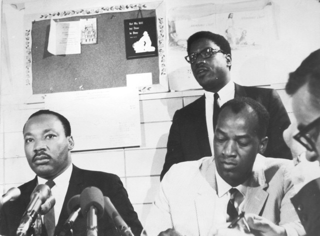 Dr. Robert Green, lower right, is shown with Rev. Martin Luther King Jr., left, at a Chicago press conference in summer 1967. Dr. Green was the education director for the Southern Christian Leader ...