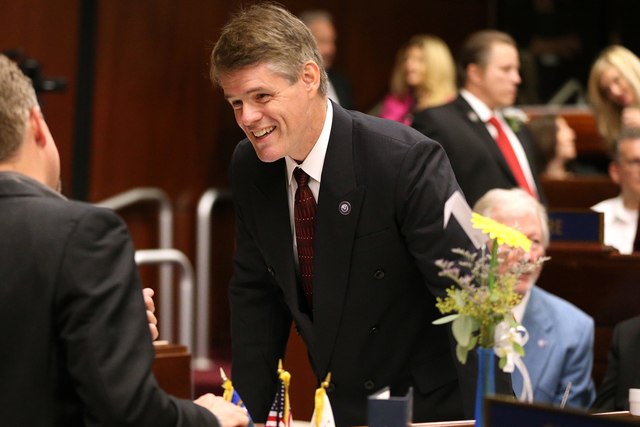 Nevada Assemblyman Chris Edwards, R-Las Vegas, talks on the Assembly floor before opening day ceremonies at the Legislative Building in Carson City on Monday, Feb. 2, 2015. (Cathleen Allison/Las V ...