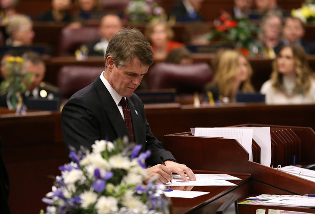 Nevada Assemblyman Chris Edwards, R-Las Vegas, signs his certificate of election on the Assembly floor before opening-day ceremonies at the Legislative Building in Carson City on Monday, Feb. 2, 2 ...
