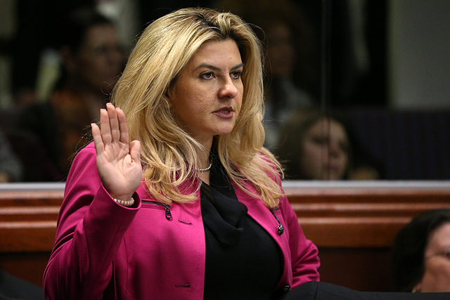 Nevada Assemblywoman Michele Fiore, R-Las Vegas, takes the oath of office during opening day ceremonies at the Legislative Building in Carson City, Nev., on Monday, Feb. 2, 2015. (Cathleen Allison ...