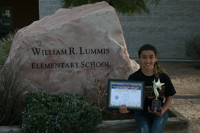 Lexie Wilder, 11, holds awards outside Lummis Elementary School in this undated photograph. Lexie was honored as Citizen of the Month for February 2015 by the Las Vegas City Council for her contin ...