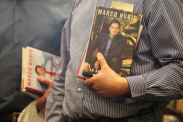 Bryan Thiriot holds a book by U.S. Sen. Marco Rubio, R-Fla., as he waits in line to get it signed at Barnes and Noble, 2191 N. Rainbow Blvd. Wednesday, Feb. 18, 2015. (Erik Verduzco/Las Vegas Revi ...