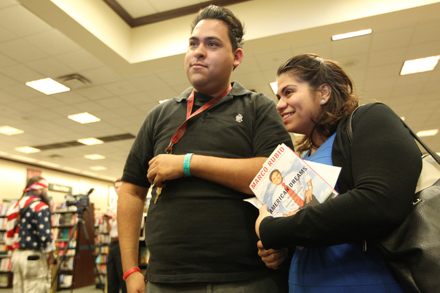 Immigration activists Jose Macias, left, and Astrid Silva, wait in line during a book signing by U.S. Sen. Marco Rubio, R-Fla., of his book, American Dreams: Restoring the Land of Opportunity, at  ...