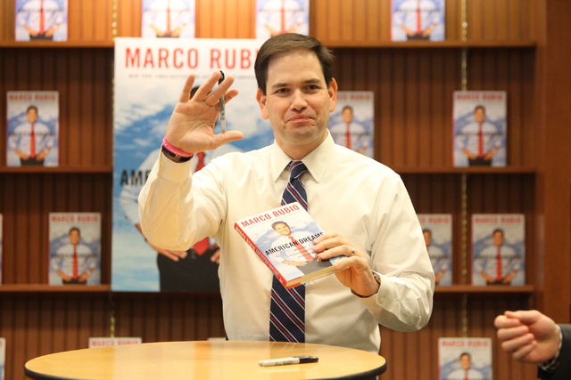 U.S. Sen. Marco Rubio, R-Fla., waves during a book signing of his book, American Dreams: Restoring the Land of Opportunity, at Barnes and Noble, 2191 N. Rainbow Blvd. Wednesday, Feb. 18, 2015. (Er ...
