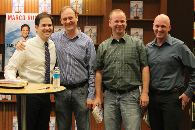 U.S. Sen. Marco Rubio, R-Fla., from left, poses for a photo with his childhood friends from left, Bryan Thiriot, and his brothers Nathan, and Bryce during a book signing of his book, American Drea ...