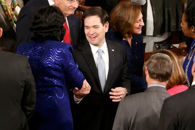U.S. Sen. Marco Rubio, R-Fla., is greeted by colleagues as he arrives to listen to President Barack Obama deliver his State of the Union address to a joint session of the U.S. Congress on Capitol  ...