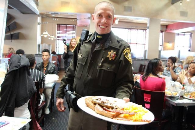 Las Vegas Metropolitan Police Department officers serve pancakes for charity Feb. 19, 2015, at Hash House A Go Go, 6800 W. Sahara Ave., in honor of National Pancake Week. The officers were joined  ...
