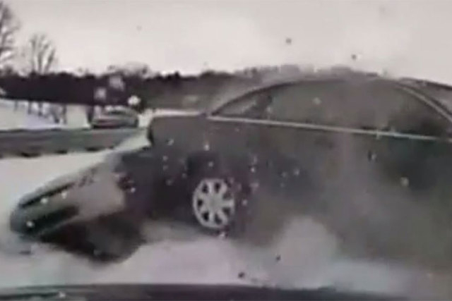 A police officer in Michigan  escaped serious injury after a car crashed into the officer and another vehicle during a weather-related accident. (Screengrab/CNN)