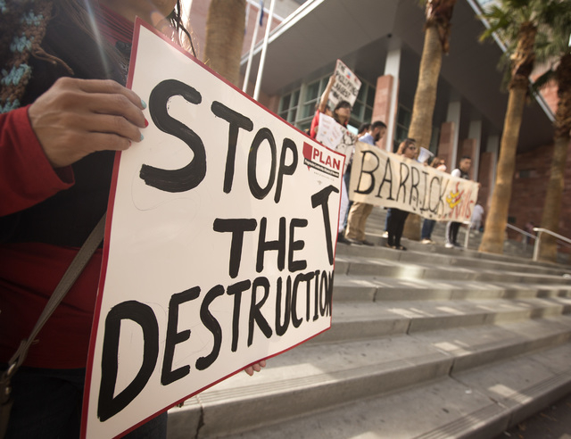 Environmental advocates rallying against Barrick Gold Corporation gather in front of the Regional Justice Court on Tuesday, Feb. 3, 2015. About 15 demonstrators gather in support of Philippine res ...