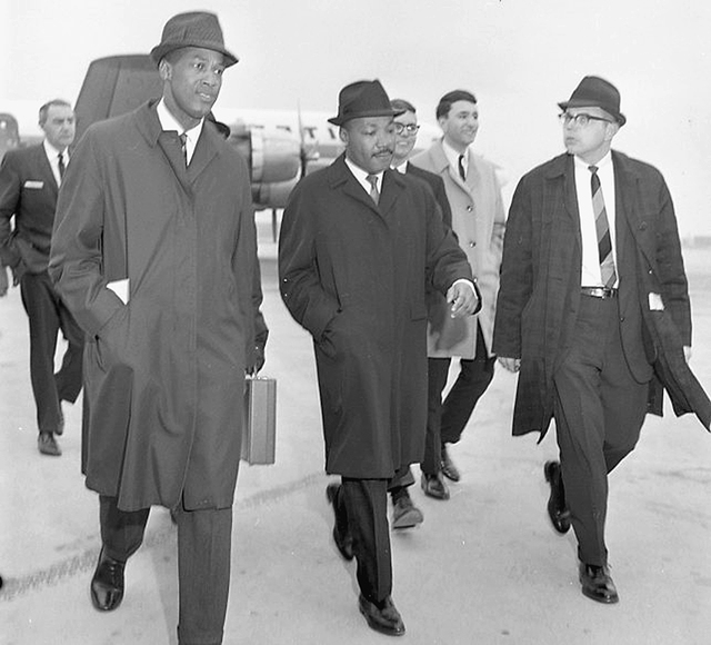 Dr. Robert Green, left, is shown with Rev. Martin Luther King Jr., center, arriving at a Lansing, Mich., airport on Feb. 11, 1965. Dr. Green was the education director for the Southern Christian L ...
