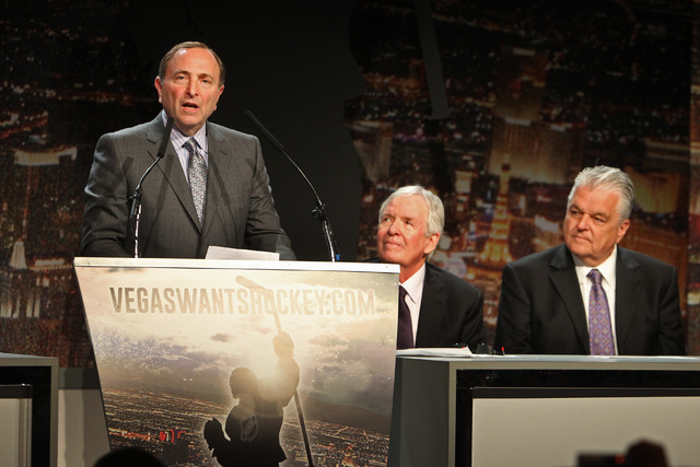 NHL Commissioner Gary Bettman speaks at an event to kick off an NHL ticket deposit drive being held to try and draw an NHL team to Las Vegas Tuesday, Feb. 10, 2015, at the MGM Grand. Listening are ...