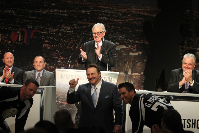 Bill Foley, center rear, announces the launch of the NHL team ticket deposit drive for a Las Vegas team, with Rossi Ralenkotter, from left, president of Las Vegas Convention and Visitors Authority ...
