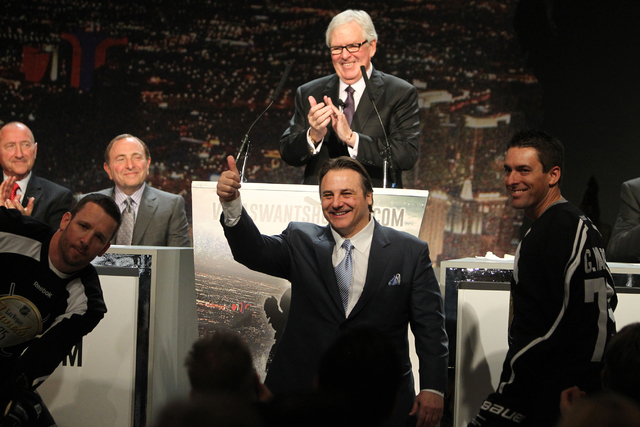 Gavin Patrick Maloof, vice chairman of Maloof Companies, center, gives a thumbs up as Bill Foley, center rear, announces the launch of the NHL team ticket deposit drive for a Las Vegas team, with  ...