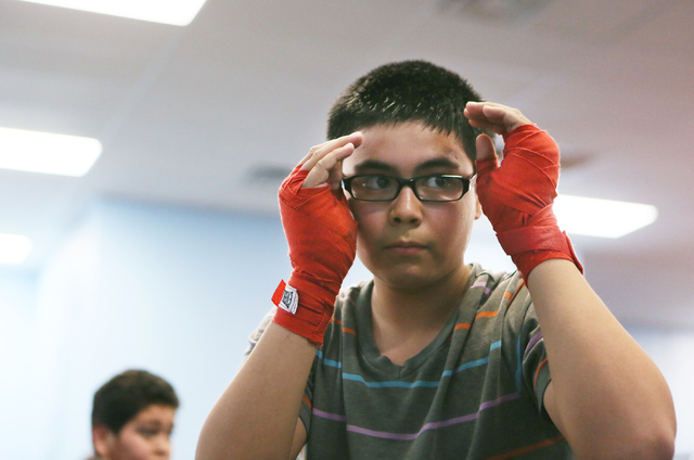 Enrique Ayala, 14, holds his hands ready during a youth boxing fitness class for ages 8 to 18 at the Richard Steele Boxing Club, 2475 W. Cheyenne Ave., Jan. 21. The club, owned by former boxing re ...