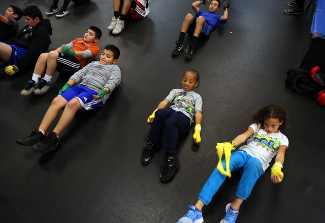 Youth work out during a boxing fitness class for students ages 8 to 18 at the Richard Steele Boxing Club Wednesday, Jan. 21, 2015, in North Las Vegas. The club, which is owned by former boxing ref ...