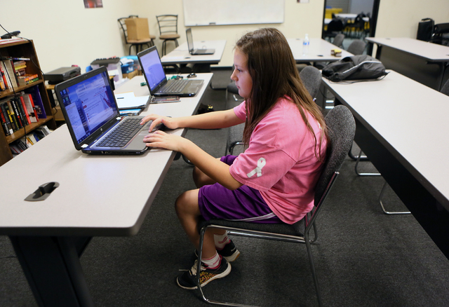 Kylee Westphal, 11, works in the tutoring center at the Richard Steele Boxing Club Wednesday, Jan. 21, 2015, in North Las Vegas. The club, which is owned by former boxing referee Richard Steele, o ...