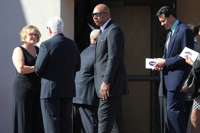 Former UNLV basketball players Jackie Robinson, center, and Richard Box, right, attend the funeral of former UNLV hall of fame basketball coach Jerry Tarkanian at Our Lady of Las Vegas church in L ...