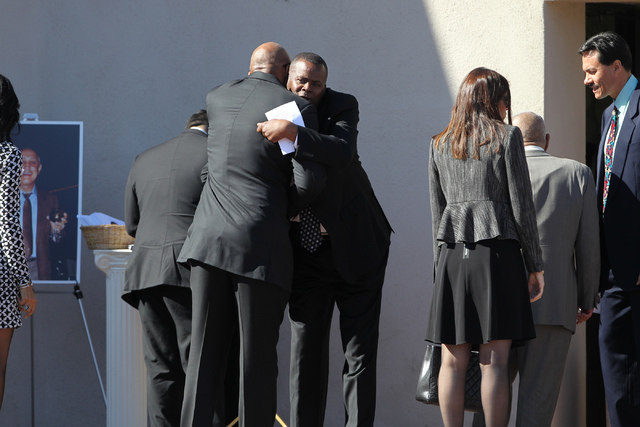 Former UNLV basketball player Jackie Robinson, hugs embraces an unidentified man during the private funeral of former UNLV hall of fame basketball coach Jerry Tarkanian at Our Lady of Las Vegas ch ...