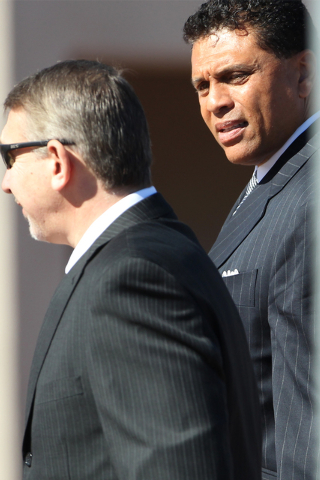 Reggie Theus, right, former UNLV basketball player, walks next to an unidentified man during the private funeral for Jerry Tarkanian, UNLV hall of fame basketball coach, at Our Lady of Las Vegas c ...