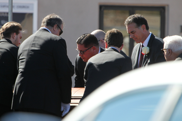 Danny Tarkanian, far right, lifts the casket of his father Jerry, UNLV hall of fame basketball coach, out of a hearse during his private funeral at Our Lady of Las Vegas church in Las Vegas Monday ...