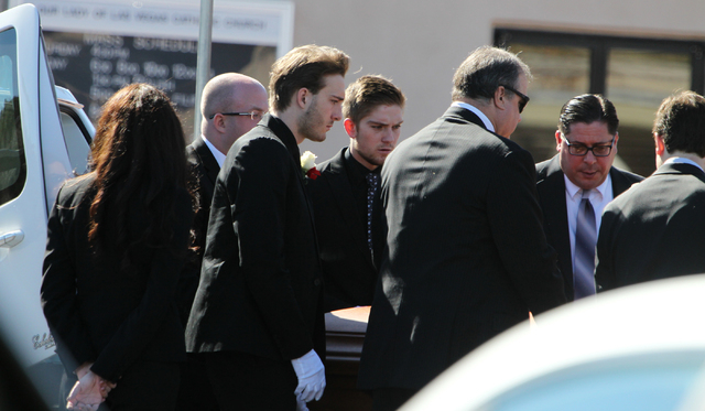 The casket of Jerry Tarkanian, UNLV hall of fame basketball coach, is lifted from a hearse during a private funeral at Our Lady of Las Vegas church in Las Vegas Monday, Feb. 16, 2015. (Erik Verduz ...