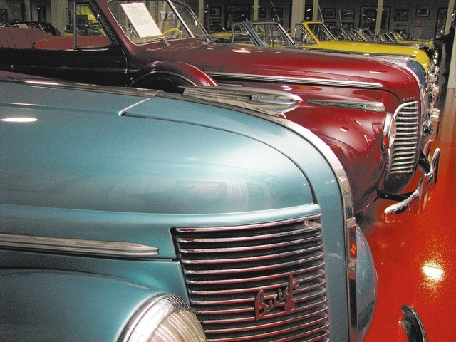 A row of Buicks arranged chronologically shows the model's evolution. The display is part of Jim Rogers' collection at a complex on Classic Cars Lane. (F. Andrew Taylor/View)