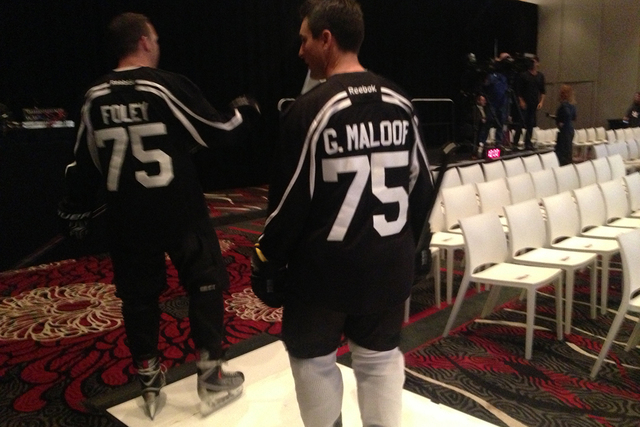 Two men dressed as NHL hockey players with Bill Foley and Gavin Maloof jersey's play a part in the NHL Las Vegas ticket drive press conference on Tuesday, Feb. 10,2015. With NHL Commissioner Gary  ...