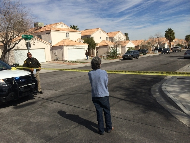 Las Vegas police were at a house in the 7900 block of Cherry River Drive Thursday, Feb. 19, 2015, looking for a suspect connected to the Feb. 12 road rage incident that ended with one woman dead.  ...