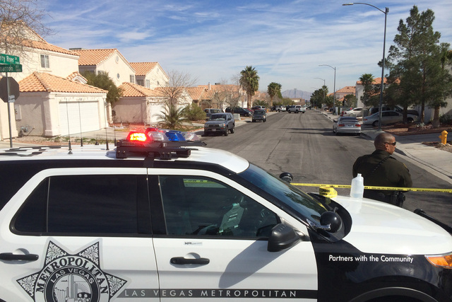 Las Vegas police were at a house in the 7900 block of Cherry River Drive, Thursday, Feb. 19, 2015, looking for a suspect connected to the Feb. 12 road rage incident that ended with one woman dead. ...