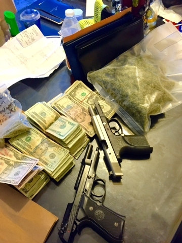 A law enforcement task force on Thursday arrested a man and confiscated 23 guns, drugs and cash during two raids in North Las Vegas, according to Metro. (Courtesy Las Vegas Metropolitan Police Dep ...