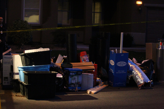 Las Vegas police serve a search warrant on a home on what appears to be an alleged marijuana grow operation on the 9600 block of Grouse Grove Avenue near Sunset Road and Grand Canyon Drive in Las  ...