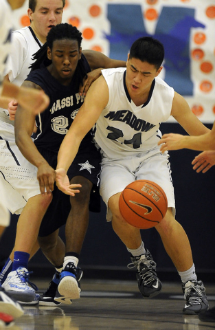 The Meadows School forward Michael Jin, right, and Agassi Prep guard Jordan Smith battle for a loose ball in the second quarter on Saturday. Agassi Prep won, 68-63. (Josh Holmberg/Las Vegas Review ...