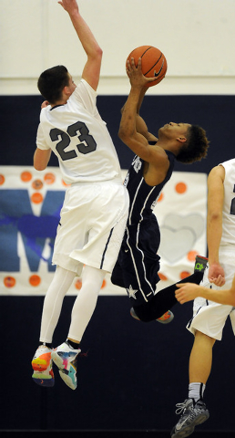 The Meadows School guard Jake Epstein (23) defends Agassi Prep guard Kobe Williams in the second quarter oon Saturday. Williams had 10 points in a 68-63 Agassi Prep win. (Josh Holmberg/Las Vegas R ...