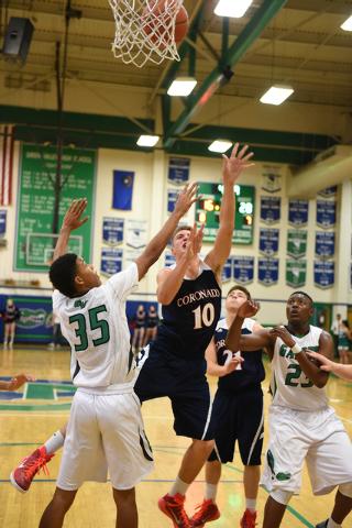 Coronado's Travis Boman (10) shoots the ball over Green Valley's Isiah Macklin (35) on Wednesday. Boman had 11 points and nine rebounds in a 72-47 Coronado win. (Martin S. Fuentes/Las Vegas Review ...
