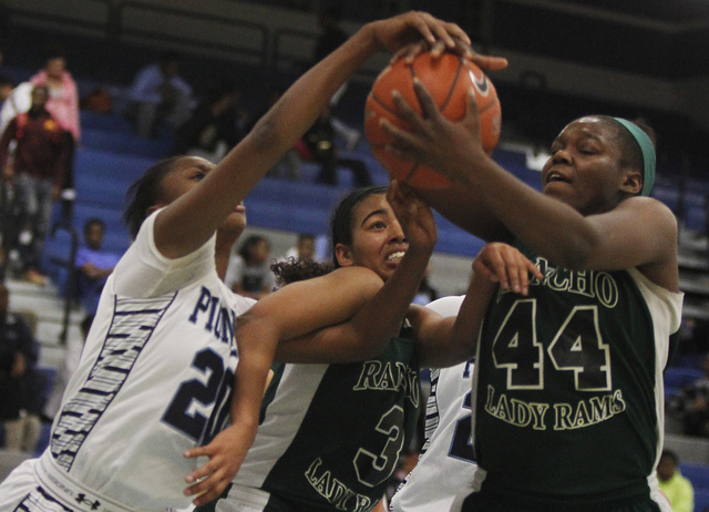 Rancho's LaKissa Martin (44) and Miyah Wilson (3) battle Canyon Springs' Alexia Thrower (20) for a loose ball during their basketball game in North Las Vegas on Tuesday, Jan. 7, 2014. (Jason Bean/ ...
