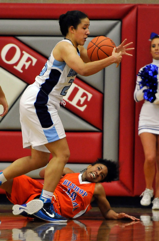 Centennial's Karina Brandon, left, grabs the ball against Bishop Gorman's Alaysia Robinson  after a foul during the Sunset Region girls basketball championship game at Arbor View High School in La ...